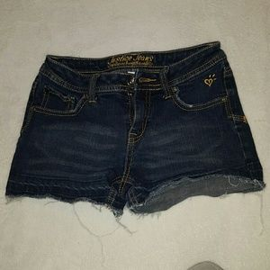 Justice dark wash denim shorts.